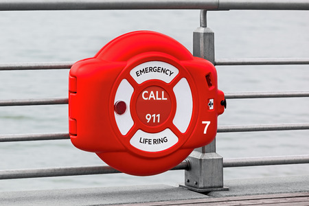 safe water: red life preserver for rescue on the water Stock Photo