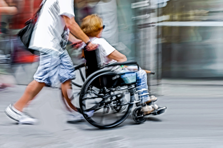 physical impairment: blurred movement disabled on a city street Stock Photo