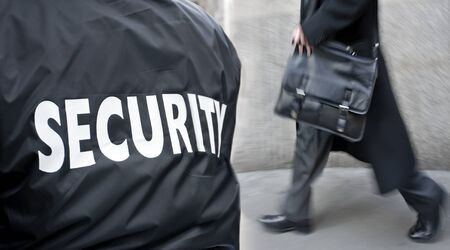 protects: label inscription on the uniform of the security guard