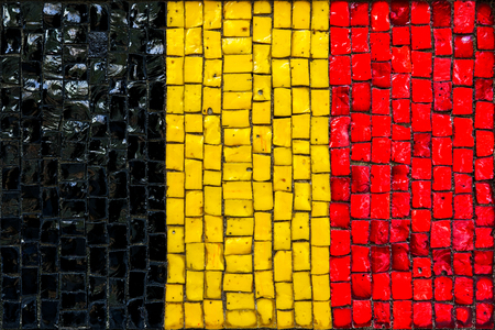 german ethnicity: Old mosaic flag of German close up Stock Photo