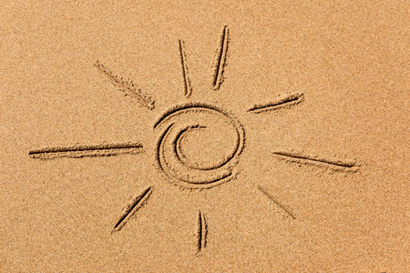 image of the sun on the sand beach coastline close-up