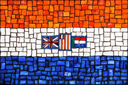accord: Old mosaic flag of South Africa close up Stock Photo