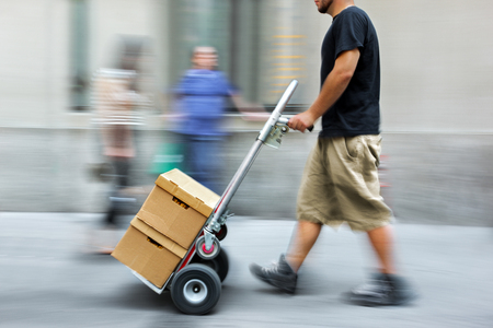 purposely: delivery goods with dolly by hand, purposely motion blur