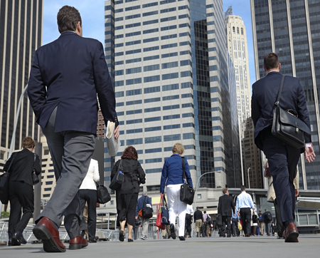 business people at rush hour walking in the street