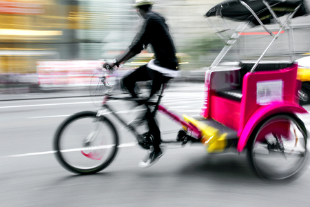 bike taxi rushing on the street in intentional motion blur Reklamní fotografie