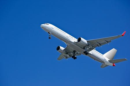 Huge plane taking off in a blue sky closeup