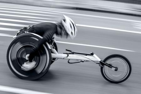 competition wheelchair in motion blur at the stadium Reklamní fotografie