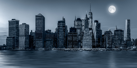 Panoramic view New York City Manhattan downtown skyline at night with skyscrapers and blue tonality Redakční