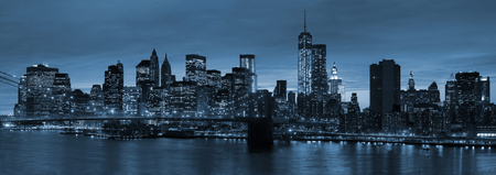 Panoramic view New York City Manhattan downtown skyline at night with skyscrapers and blue tonality Editorial
