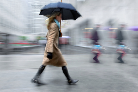 business people walking in the street on a rainy day motion blurred Reklamní fotografie