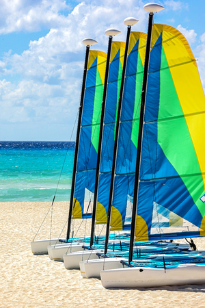 colorful sandy beach with yachting Redakční