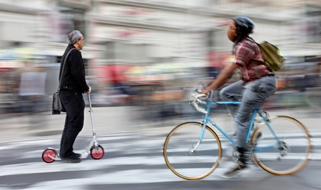 cyclist in traffic on the city roadway  motion blur Reklamní fotografie