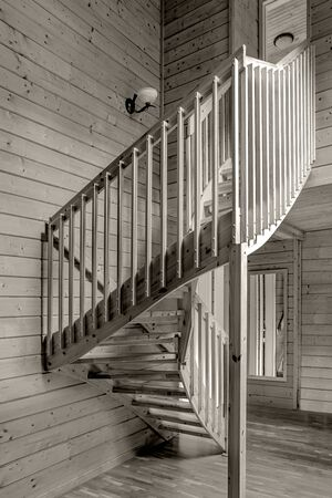 internal wooden spiral staircase leading from the first  floor to the second