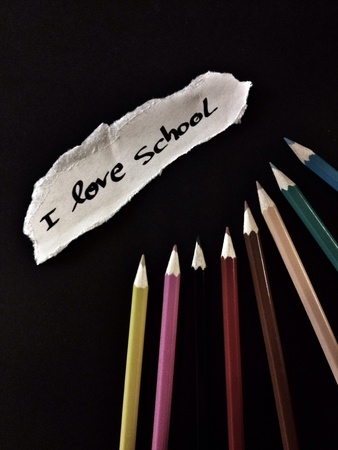 creative: Color pencils and phrase I love school on black background Stock Photo