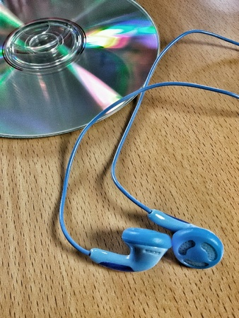 head phones: Close view of compact disc and blue head phones