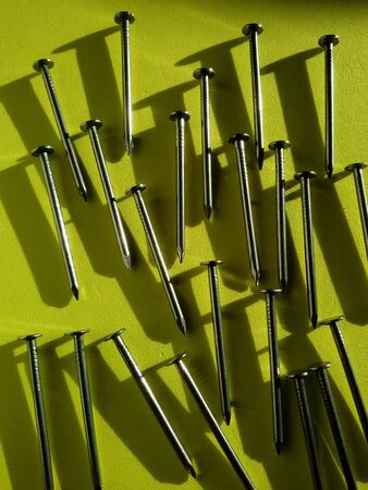 close: Close view of isolated nails in colorful  background
