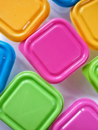 lids: Close view of plastic boxes and colourful  lids Stock Photo