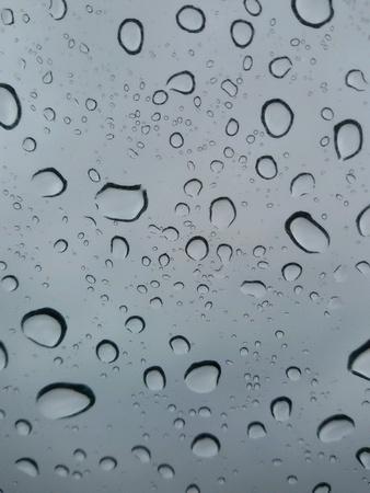 closeup: Closeup view of drops of rain in glass Stock Photo