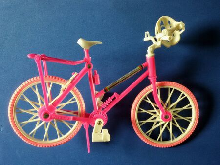 close: Close view of pink toy bicycle