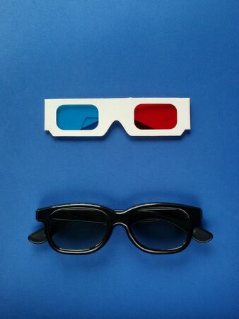 eye: Close view of 3D glasses in blue background