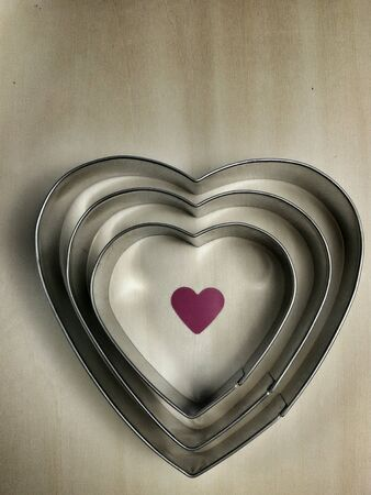 metallic: View of heart shapes with pink heart  in the middle