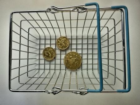 metallic: Three coins inside metallic shopping basket