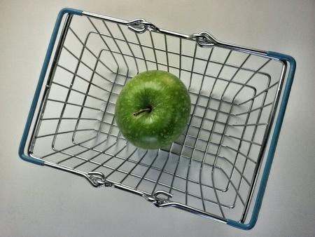 mettalic: Green apple inside a mettalic shopping basket