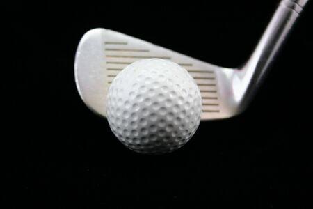 Golf club and ball. 版權商用圖片