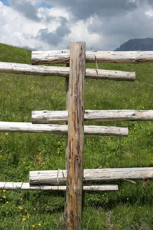 greeen: wooden fence in the mountains