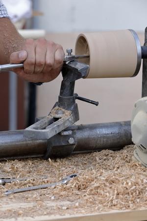 wood turning: turning carpenter Stock Photo
