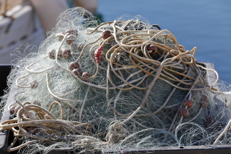 trawler net: Large fishing nets lying to dry in the sun