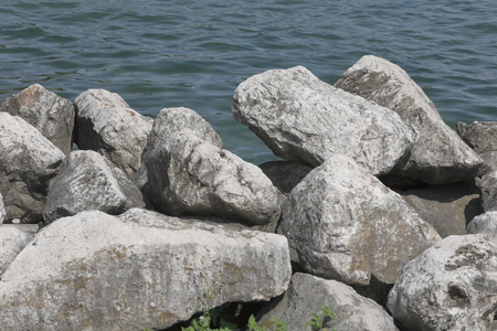 Big rocks form a cliff on the sea