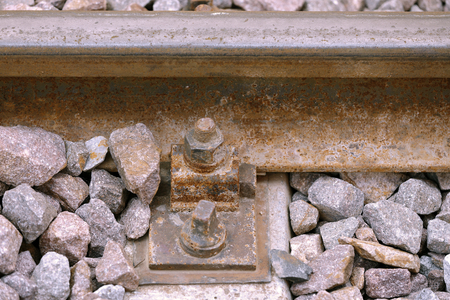 metal structure: nuts and bolts of an abandoned track Stock Photo