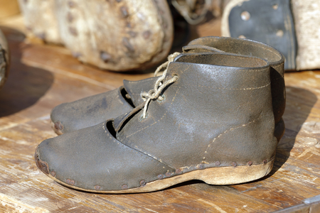 two old leather shoes with string cord