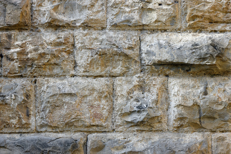 background of wall of large protruding stones