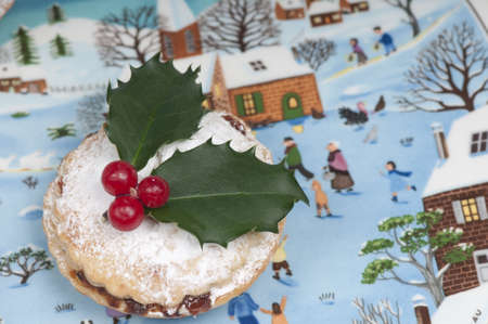mincemeat: Traditional Christmas mince pie on a beautiful plate depicting a Christmas snow and Nativity scene. Stock Photo
