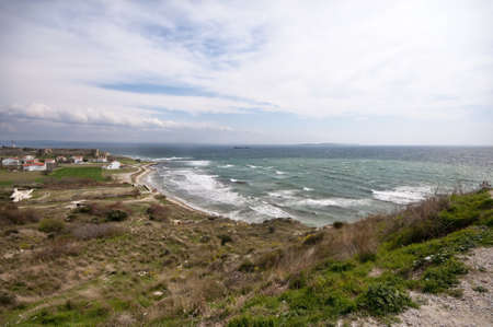 futility: V Beach with cenetery, castle and town, Gallipoli.  The site of the landing of the British forces during the First World War.  Taken from the position of the Turkish gun emplacements.