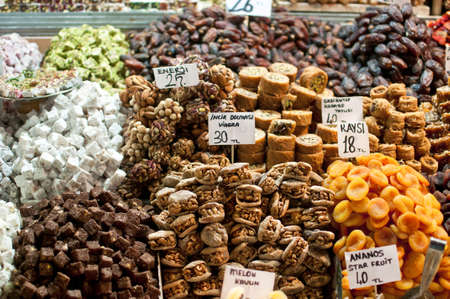 genuine good: Wonderful selection of Turkish sweets, dried fruits and nuts in a stall in the Istanbul spice market.  Two of the labels read Viagra and enerji. Including apricots, turkish delight, baklava, figs stuffed with walnuts.