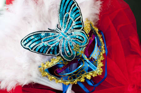garish: Venetian style sequinned carnival  mask with a butterfly and feathers. Stock Photo