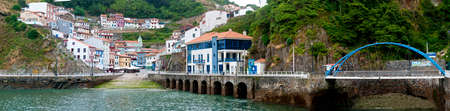 slipway: Panorama of the Asturian Spanish town of Cudillero, showing the harbour, slipway and multicoloured town houses.  This is a popular tourist destination.