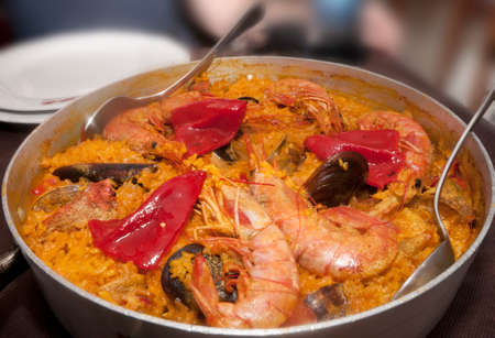 almejas: Spanish seafood paella with giant prawns, red peppers, mussels, clams, crabs and succulent golden rice.