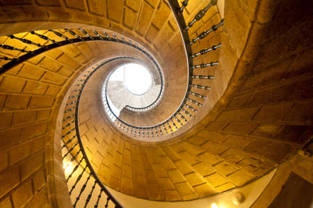 View up a dramatic double spìral staircase.
