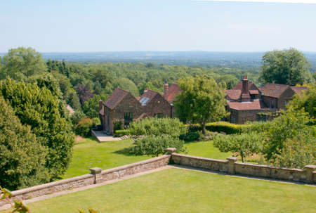 minister of war: View from Winston Churchills home, Chartwell House, across the woodlands, gardens and the rolling hills of Kent, England.  The stables in the photo are where Winston Churchill had his studio for painting. Editorial