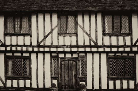 English half-timbered black and white Tudor houses from Lavenham, Suffolk England.  Antique black and white photo. Stock Photo