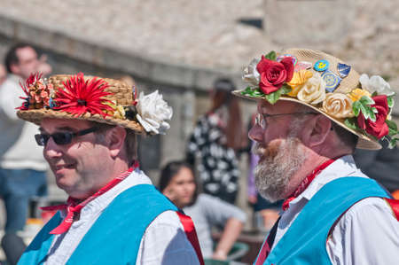morris: SEGOVIA  SPAIN - MARCH 16 2014 - East Suffolk Morris Men  in the ancient Roman city of Segovia, Spain with blue and white uniform, and straw hats decorated with flowers.  Traditional English folk dancers