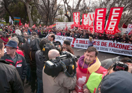 MADRID SPAIN - MARCH 10: Demonstration taking place in Madrid against cuts  that have been imposed due to the economic crisis. TV camera operators face the demonstrators. March 10, 2013 in Madrid.