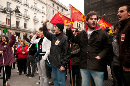 MADRID SPAIN - MARCH 10: Demonstration taking place in central Madrid against the cuts in education, social benefits, salaries and health that have been imposed as  solutions to the economic crisis.  The communist party demonstrating vociferously in the c