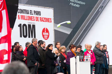 MADRID SPAIN - MARCH 10: Demonstration taking place in central Madrid against the cuts in education, social benefits, salaries and health that have been imposed as  solutions to the economic crisis.  Speeches being made on the podium in the central square