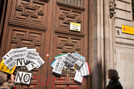 MADRID SPAIN - MARCH 10: Demonstration taking place in central Madrid against the cuts in education, social benefits, salaries and health that have been imposed as  solutions to the economic crisis.  Placards stuck onto the door of the Ministry of Finance Editorial