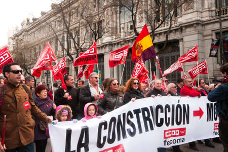 MADRID SPAIN - MARCH 10: Demonstration taking place in central Madrid against the cuts in education, social benefits, salaries and health that have been imposed as  solutions to the economic crisis.  The  demonstration moves past the Bank of Spain. This i